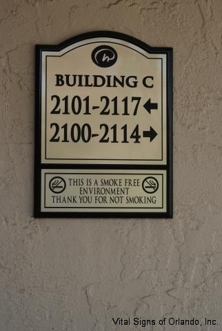 directions-to-buildings-plaque-on-concrete