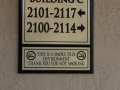 directions-to-buildings-plaque-on-concrete