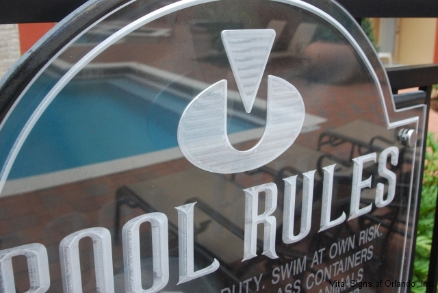 close-symbol-and-letter-on-pool-sign